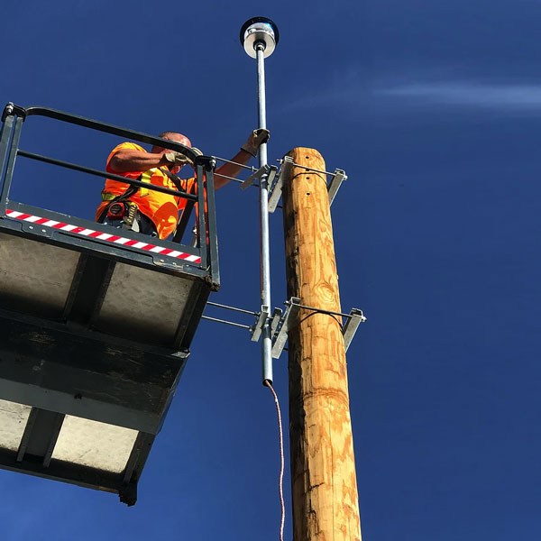 Installation of lightning suppressor on pole